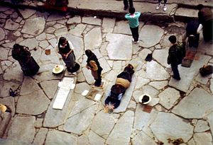 Buddhist pilgrims prostrating at the Jokhang.