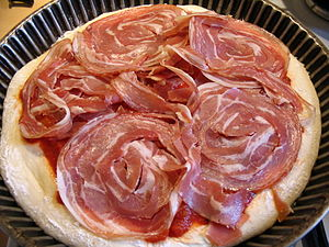 Pizza prepared with sliced rolled pancetta