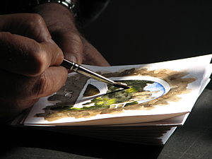 A watercolor painter working in Dolceacqua (Li...