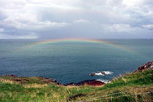 English: Sea Rainbow. This rainbow appeared af...