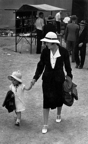 English: Mother and child at the show, 1938. B...