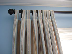 Detail of the curtains shows how the stripes a...