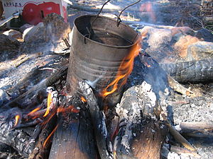 English: A billycan on a campfire. Author's ca...