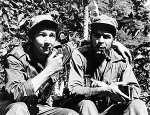 Raul Castro, left, with has his arm around sec...