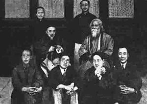 Tagore (center, at right) visits with academic...