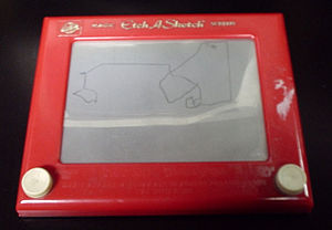 The classic red-and-white Etch A Sketch model