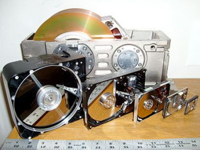 Six hard disk drives with cases opened showing...