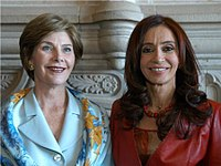Cristina Kirchner (on the right) next to U.S. First Lady Laura Bush, on 5 November 2005, during the state visit of the Bushes for the Mar del Plata Summit of the Americas.