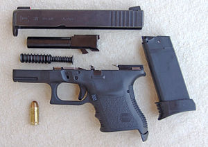 English: Pistol Glock 30 caliber 45 ACP, strip...