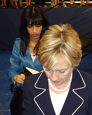 Hillary Clinton, followed by Huma Abedin. Gree...