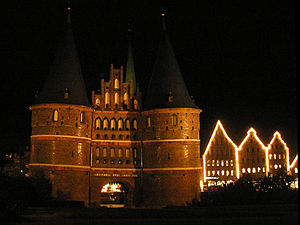The Holstentor in Lübeck at night with Christm...