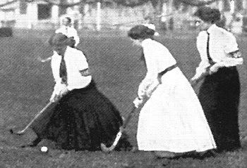 Women playing field hockey ca. 1910, when long...