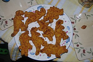 English: Dinosaur formed chicken(?)-nuggets, e...