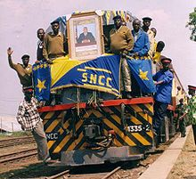 The ceremonial first train on the newly reconstructed Lubumbashi–Kindu railway, 2004, bearing a portrait of Joseph Kabila.