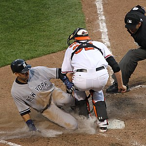 Matt Wieters blocks home plate from Derek Jeter.