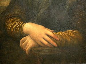 Detail of Lisa's hands, her right hand resting...