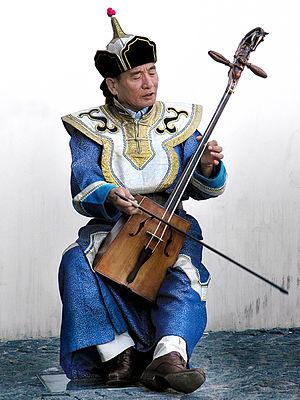 Musician playing the traditional Mongolian mus...