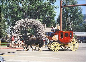 Jackson, Wyoming. A Concord stagecoach rounds ...