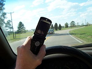 Person using cell phone while driving.