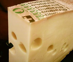 Emmentaler (also known as Swiss Cheese), while...