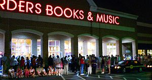 Potter fans wait in lines outside a Borders in...