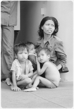 South China Sea....A refugee woman cares for three small children on the replenishment oiler USS Wabash, AOR-5.... - NARA - 558538