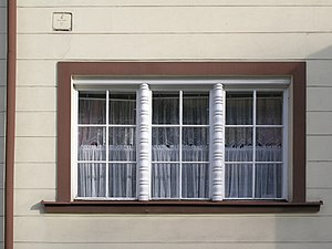 Muntins divide each window into six panes of g...