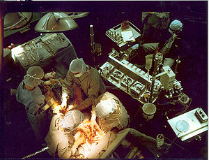 A perfusionist in front of a heart-lung machin...
