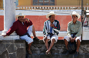 English: Tz'utujil men hanging around Santiago...