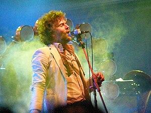 English: Wayne Coyne performing with The Flami...