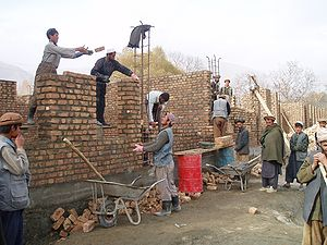 Afghan construction workers building a school ...