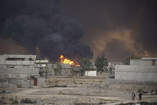 Cityscape of Qayyarah town on fire.The Mosul District, Northern Iraq, Western Asia. 09 November, 2016