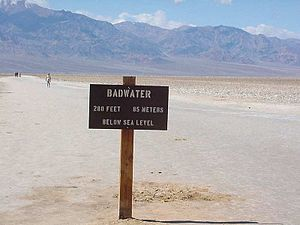 English: A view from Badwater with a sign, of ...