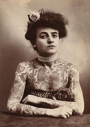 A woman showing images tattooed or painted on ...