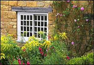 English: Cottage Garden with Summer Flowers Co...