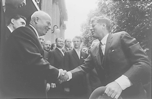 US President John F. Kennedy shaking hands wit...