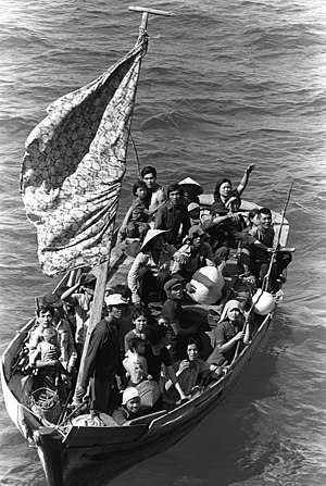 35 Vietnamese refugees wait to be taken aboard...
