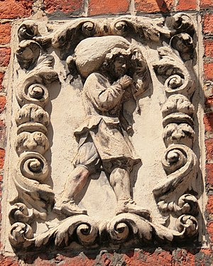 Bruges (Belgium), carved stone sign depicting ...