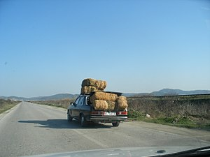 Car loaded with hay in Southern Albania
