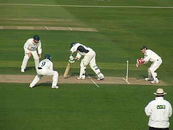 Two close fielders playing for Nottinghamshire...