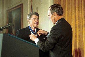George H. W. Bush awarding former President Ro...