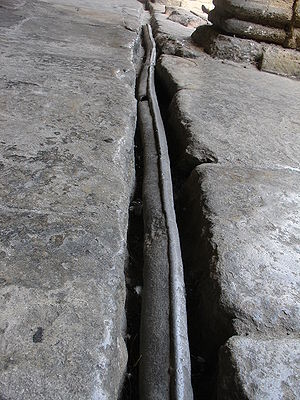 Lead pipe in Roman bath in Bath, Somerset, Eng...