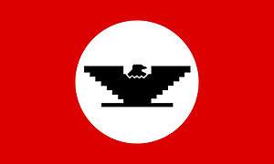 A United Farm Workers flag containing the Huel...
