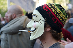 At the Occupy London protest, a man wearing a ...