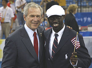 President George W. Bush poses for a photo wit...
