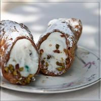 Cannoli siciliani on a plate.