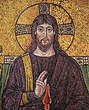 6th century mosaic in Ravenna portrays Jesus long-haired and bearded, dressed as a Greco-Roman priest and king. He appears as the Pantokrator enthroned as in the Book of Revelation, donning regal Tyrian purple, gesturing a benediction, with a sun cross halo behind his head. Though depictions of Jesus are culturally important, no undisputed record of Jesus' appearance exists.