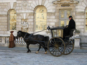 Hansom cab and driver adding character to peri...