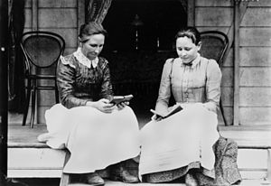 English: Two women reading on a verandah at In...