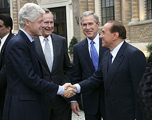 From left to right: Bill Clinton, George H. W....